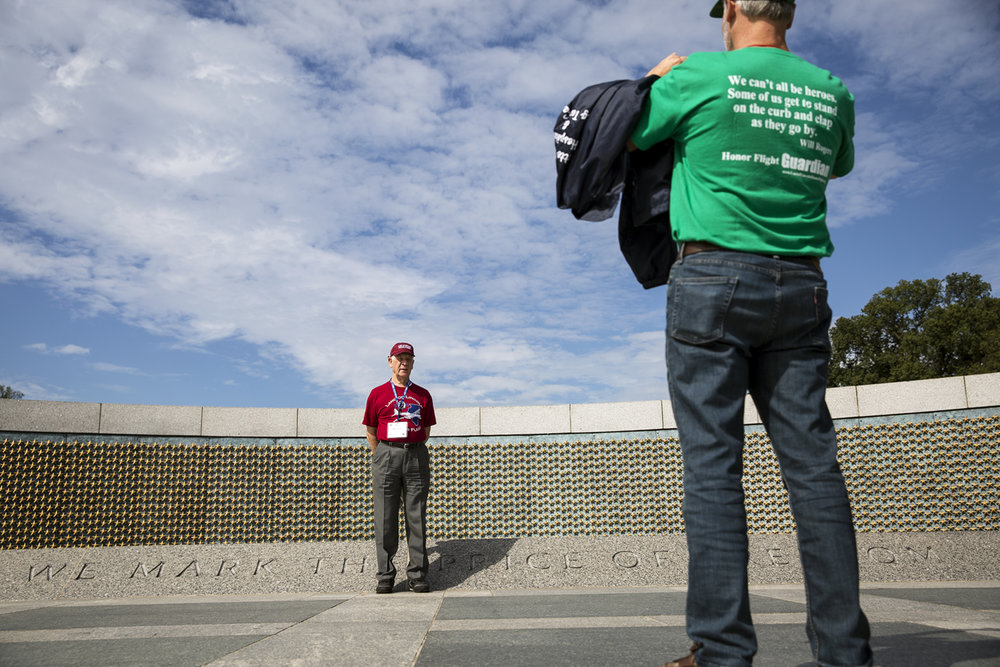 Brian Dossett takes a picture of his father, Phil Dossett, in front of the The Freedom Wall at the World War II Memorial in Washington, D.C. Tuesday, Sept. 12, 2017. Each of the 4,048 stars on the wall represent 100 American killed in the war. [Rich Saal/The State Journal-Register]