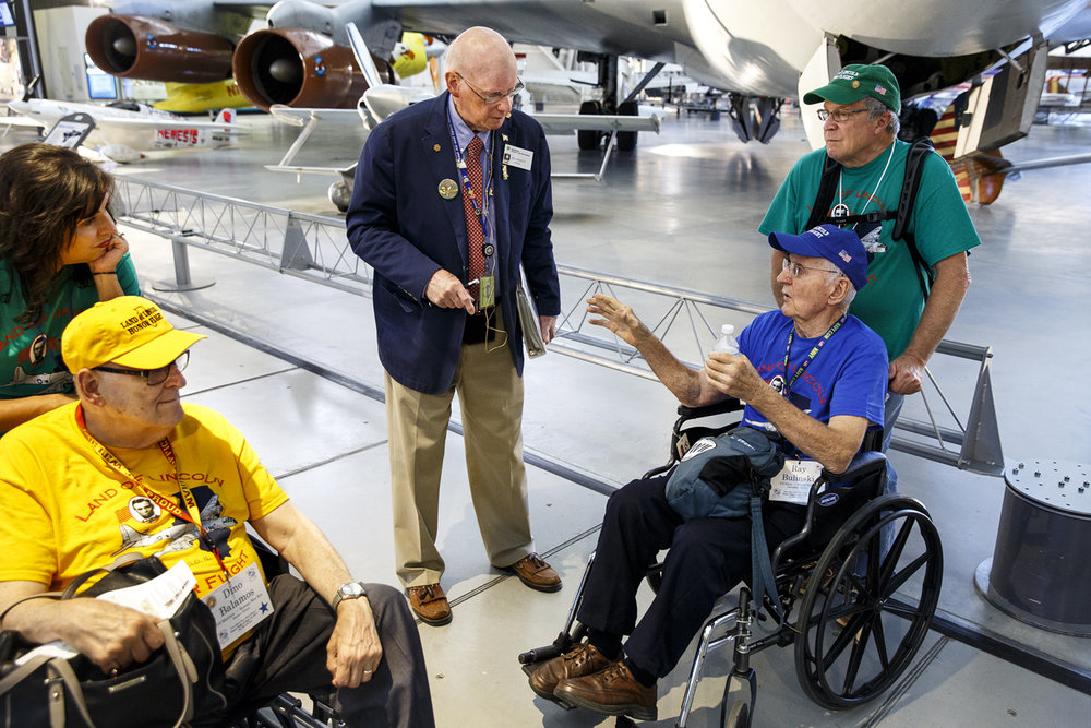 """The Enola Gay saved my life,"" Ray Bulinski tells Jim Brinker, a docent at the Smithsonian National Air and Space Museum, Steven F. Udvar-Hazy Center in Chantilly, Va. Bulinski had been assigned to an invasion force to attack mainland Japan in 1945 but it became unnecessary after the U.S. dropped nuclear bombs on Hiroshima and Nagasaki, ending the war. The Enola Gay, a B-29 Superfortress long-range bomber that dropped the bomb on Hiroshima, is on display at the museum. Bulinski, his guardian Johnny Adelman, and Dino Balamos and his daughter, Kathy Ganley, listened to Brinker's presentation on the bomber."