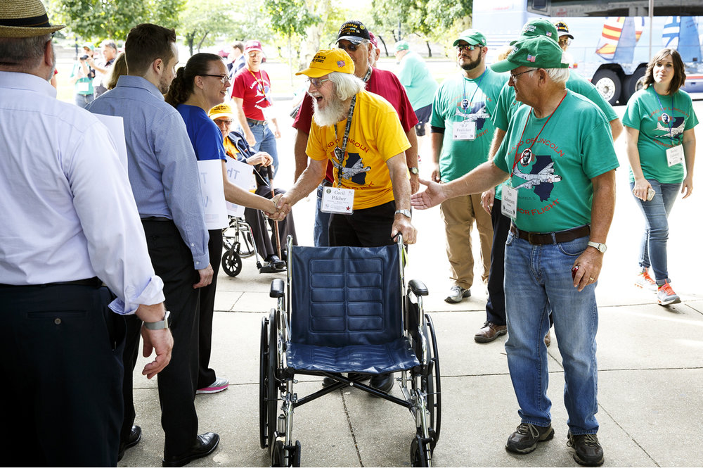 Cecil Pilcher shakes hands with greeters at the World War II Memorial in Washington, D.C. Tuesday, Sept. 12, 2017. Volunteers were there specifically to welcome veterans on the Land of Lincoln Honor Flight. Pilcher is a U.S. Army veteran of the Korean War. [Rich Saal/The State Journal-Register]