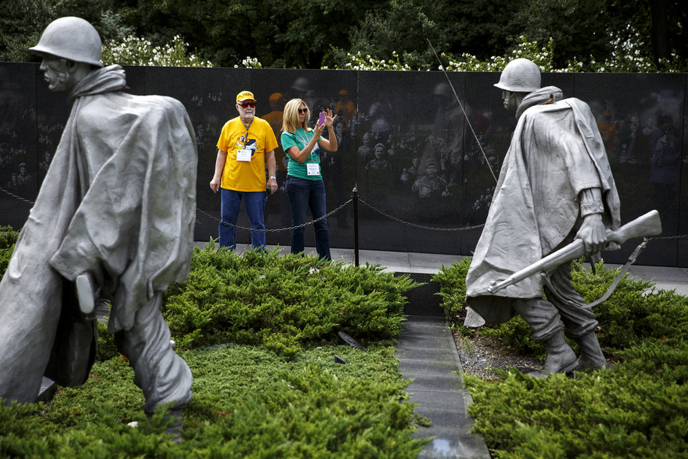Elmer Fred, a U.S. Army veteran of the Korean War, and his guardian, Carolyn Fleischli, tour the Korean War Veterans Memorial.