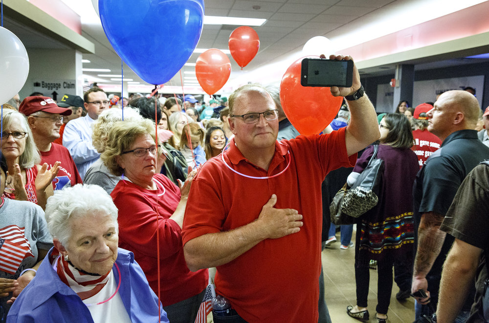 Hundreds of people lined the main terminal at Springfield's Capital Airport to welcome veterans home from the Land of Lincoln Honor Flight to Washington, D.C. Tuesday, Sept. 12, 2017. [Rich Saal/The State Journal-Register]