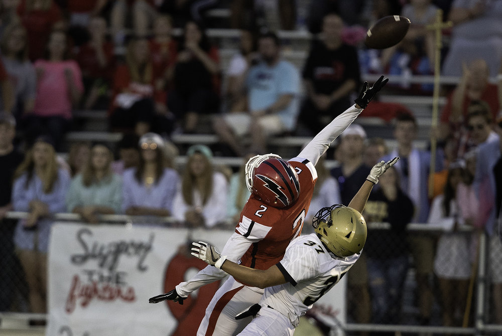 Glenwood's Devin Foy and Sacred Heart-Griffin's Jared Viele leap for a pass at Glenwood High School Friday, Sept. 15, 2017. [Ted Schurter/The State Journal-Register]