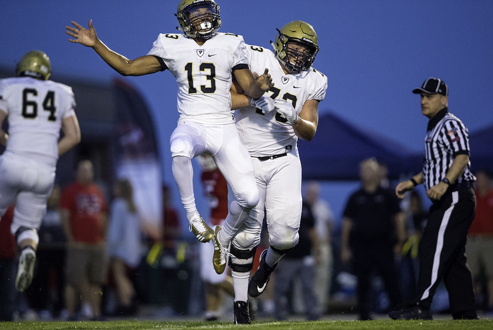 Sacred Heart-Griffin's Spencer Redd, left, and Sacred Heart-Griffin's Barrett Kraft celebrate Redd's first-half touchdown at Glenwood High School Friday, Sept. 15, 2017. [Ted Schurter/The State Journal-Register]