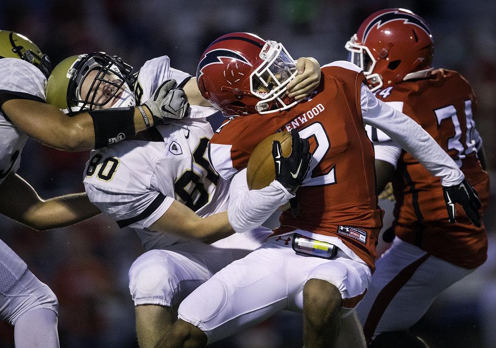Sacred Heart-Griffin's Garrett Mohn tackles Glenwood's Devin Foy in the first half at Glenwood High School Friday, Sept. 15, 2017. [Ted Schurter/The State Journal-Register]