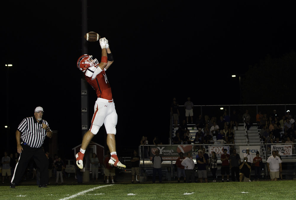 Glenwood's Cole Hembrough leaps for a high snap that goes over his head on an attempted punt at Glenwood High School Friday, Sept. 15, 2017. Sacred Heart-Griffin recovered the loose ball and scored a few plays later. [Ted Schurter/The State Journal-Register]