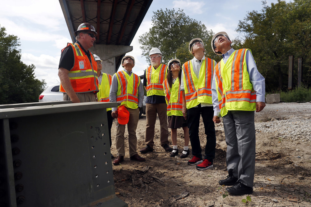 Steve Halverson, President of Halverson Construction Company of Springfield, describes the construction of the $75 million Illinois Route 104 bridge over the Illinois River to, from left, Tatsuki Aragane, Ashish Adhikari, Jonathan GoldbergBelle, Xu Jiaying, Ryogo Sakai and Takashi Shimizu. The students and professor are part of the Sister Cities exchange program between the University of Illinois at Springfield (UIS) and Ashikaga Institute of Technology. [Ted Schurter/The State Journal-Register]