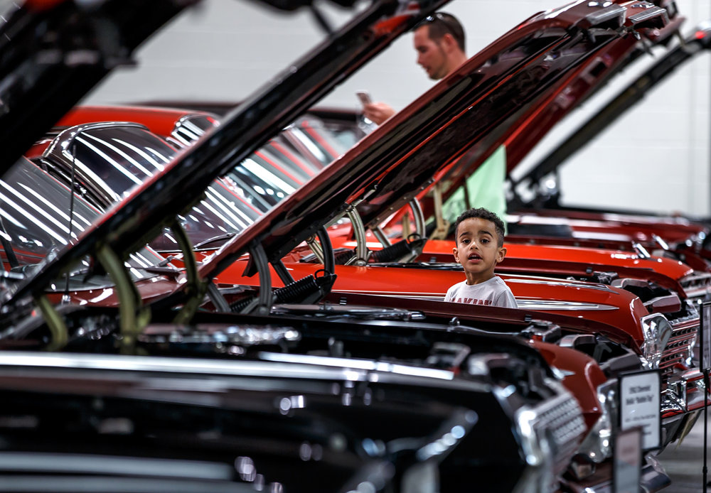 Ethan Crabtree, 5, of Chatham, Ill., takes in the classic cars on display in Dick LeviÕs private collection during the 2nd Annual ÒTake Flight in the Fight Against CrimeÓ Crime Stoppers Hangar Party at the Levi, Ray & Shoup Inc. Hangar at the Abraham Lincoln Capital Airport, Sunday, Sept. 3, 2017, in Springfield, Ill. [Justin L. Fowler/The State Journal-Register]