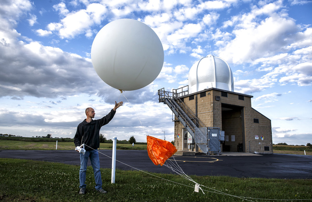 "Meteorologist Chuck Schaffer releases a weather balloon equipped with a radiosonde to measure temperature, wind speed and direction, relative humidity and pressure through the upper levels of the atmosphere at the National Weather Service at Lincoln, Tuesday, Sept. 5, 2017, in Lincoln, Ill. The NWS has started releasing balloons every six hours, instead of every twelve, from 50 sites in the central and eastern part of the U.S. to help collect data that will be used to forecast the track of Hurricane Irma.""We are launching these extra weather balloons to help sample the atmosphere because the air mass that is over our region will help determine where the hurricane tracks,"" said Schaffer. ""It's exciting from a scientific standpoint to see such a strong storm, also a very serious time knowing the impacts that could occur from this."" The balloons gather data every second and it's transmitted via radio transmitter to the dome pictured in the background. The data is then sent to supercomputers in Washington, D.C. where it is used to forecast the track of the hurricane so people in those areas can prepare ahead of time. [Justin L. Fowler/The State Journal-Register]"