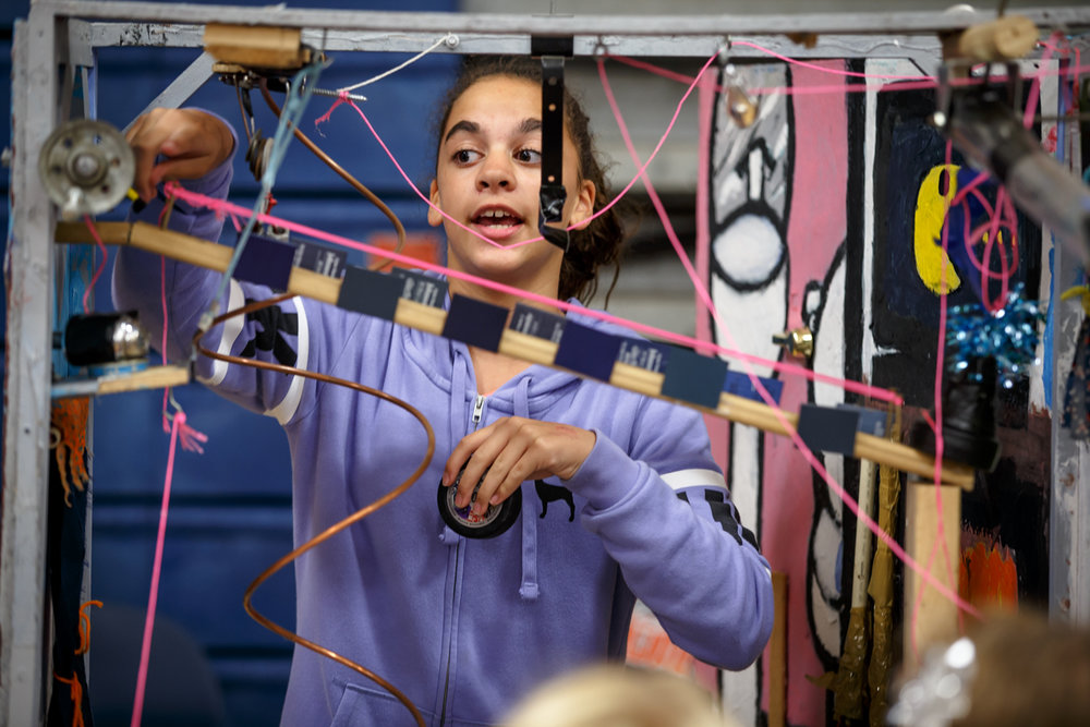 Livia Nieves, 11, a Rochester Intermediate School student, demonstrates how a Rube Goldberg Machine she helped design is built to pour a bowl of cereal during the third annual STEM Fair at the Rochester High School, Wednesday, Sept. 6, 2017, in Rochester, Ill. [Justin L. Fowler/The State Journal-Register]