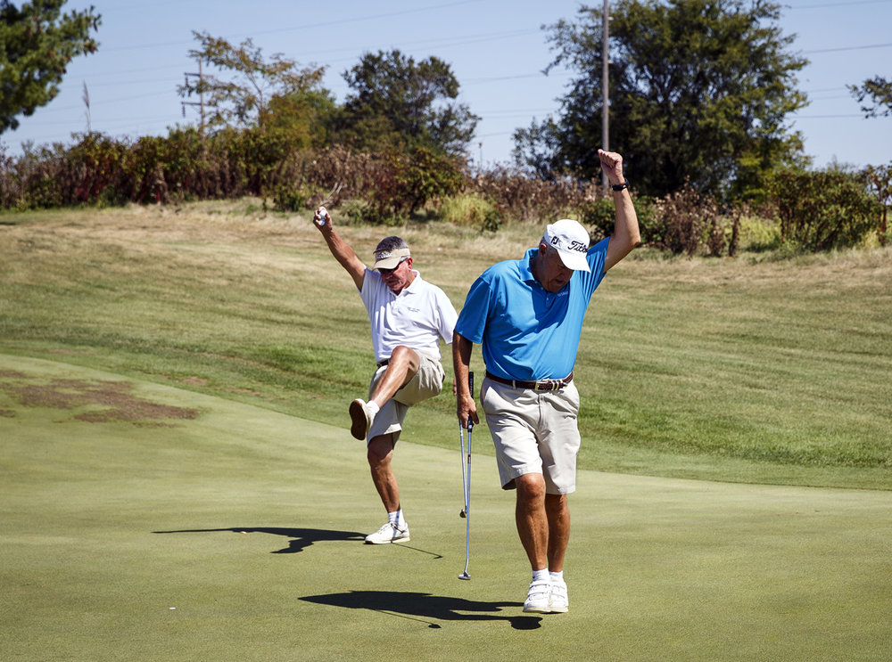 Barry Becker, left, and Jim Ketchum celebrate after Ketchum sank a putt for birdie on the No. 3 green during the 27th annual Friend-in-Deed Golf Outing at Piper Glen golf course Friday, Sept. 8, 2017. More than 100 golfers participated in this year's event, which raises funds for the annual Christmas charity. [Rich Saal/The State Journal-Register]