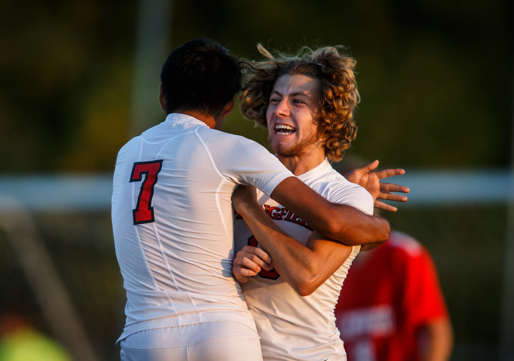 Springfield's Kelby Phillips (13) celebrates a goal with Springfield's Rolando Solis (7) to make it 1-0 against Glenwood in the first half at Lee Field, Tuesday, Sept. 19, 2017, in Springfield, Ill. [Justin L. Fowler/The State Journal-Register]