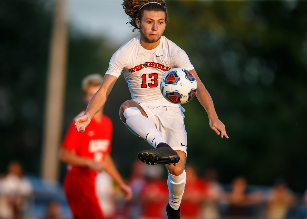 Springfield's Kelby Phillips (13) kicks a ball out of the air against Springfield in the first half at Lee Field, Tuesday, Sept. 19, 2017, in Springfield, Ill. [Justin L. Fowler/The State Journal-Register]
