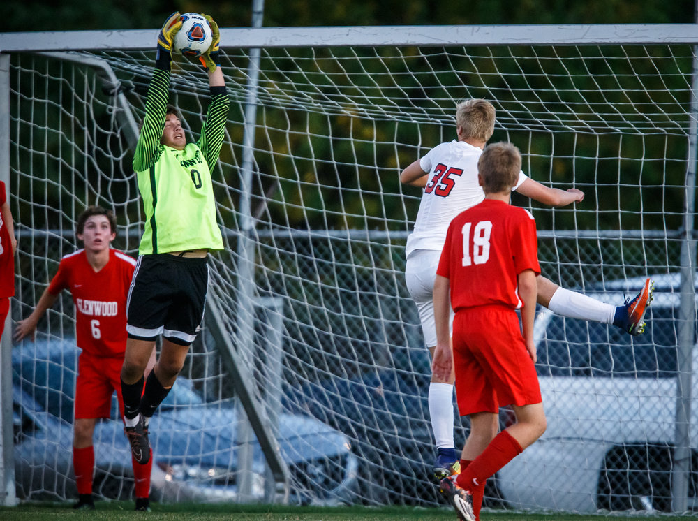 Glenwood goalkeeper Collin Cramer (0) makes a save in front of the goal against Springfield in the first half at Lee Field, Tuesday, Sept. 19, 2017, in Springfield, Ill. [Justin L. Fowler/The State Journal-Register]