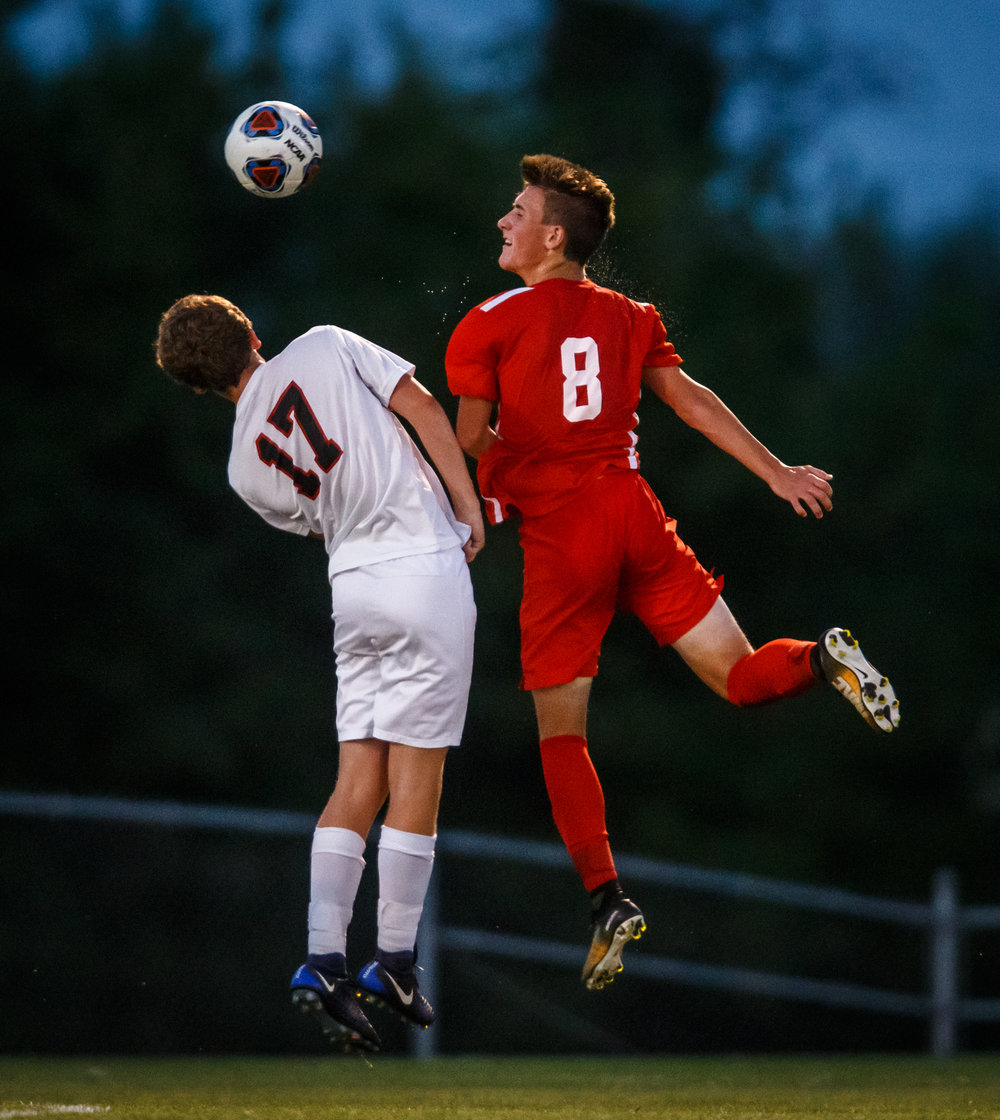 Glenwood's Evan Paoni (8) smacks a header against Springfield's Jacob Gerdes (17) in the first half at Lee Field, Tuesday, Sept. 19, 2017, in Springfield, Ill. [Justin L. Fowler/The State Journal-Register]