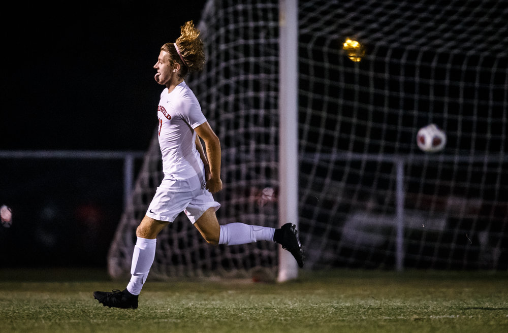 Springfield's Kelby Phillips (13) reacts as his second goal of the game goes into the net to make it 2-0 against Glenwood in the second half at Lee Field, Tuesday, Sept. 19, 2017, in Springfield, Ill. [Justin L. Fowler/The State Journal-Register]