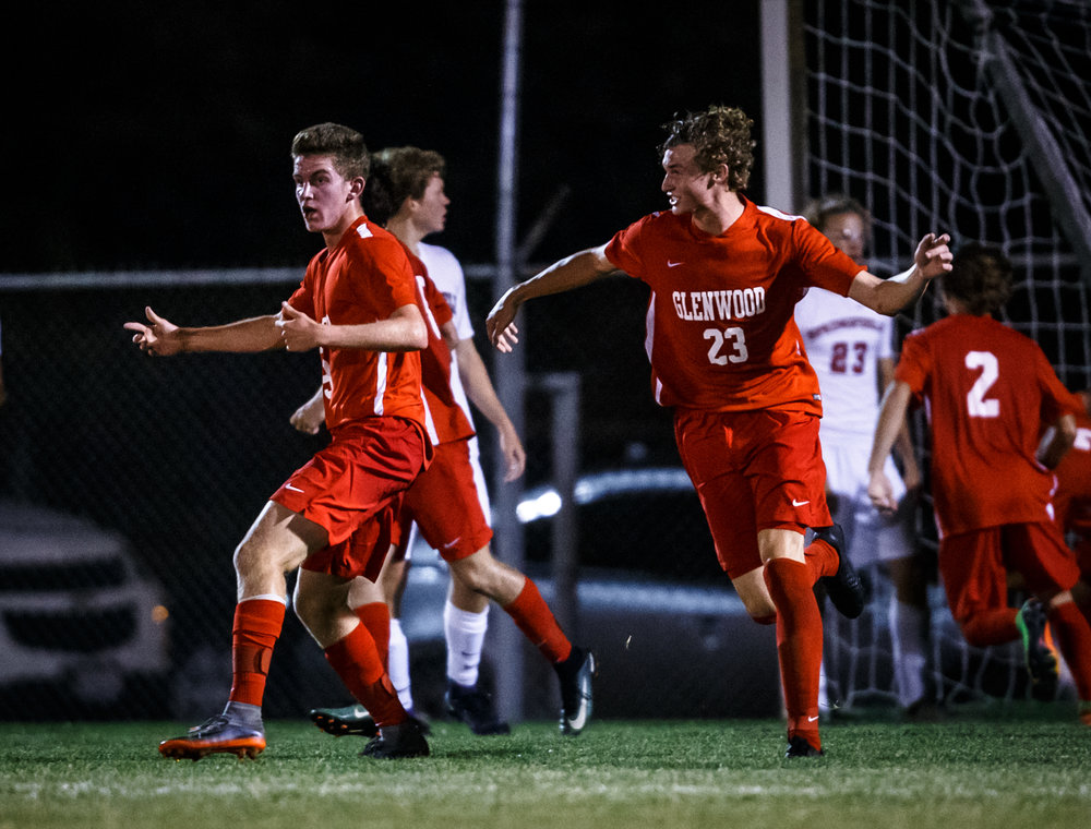 Glenwood's Evan Paoni (8) celebrates his goal that put the Titans on the board trailing Springfield 2-1 in the second half at Lee Field, Tuesday, Sept. 19, 2017, in Springfield, Ill. [Justin L. Fowler/The State Journal-Register]