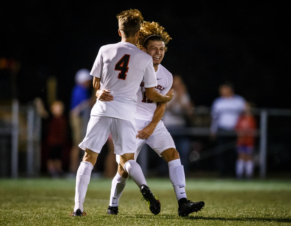 Springfield's Kelby Phillips (13) celebrates his second goal of the game with Springfield's Max Thuma (4) to make it 2-0 against Glenwood in the second half at Lee Field, Tuesday, Sept. 19, 2017, in Springfield, Ill. [Justin L. Fowler/The State Journal-Register]