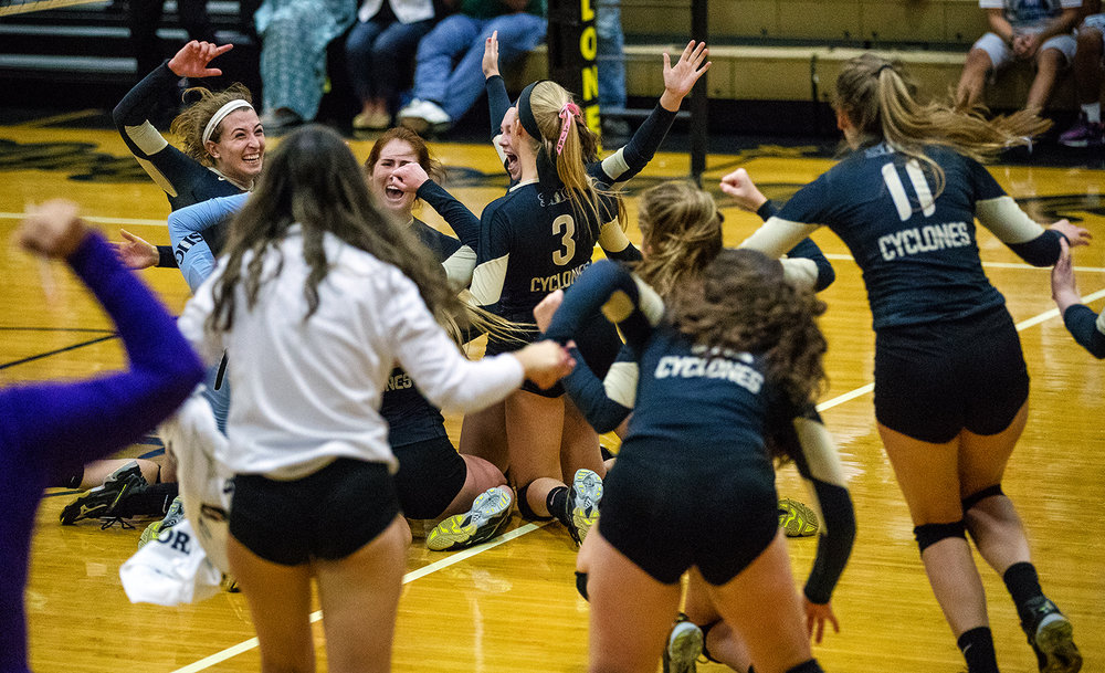 The Cyclones rush the floor as they celebrate their win against Springfield during the City Volleyball Tournament at Belz Gymnasium Thursday, Sept. 21, 2017. [Ted Schurter/The State Journal-Register]