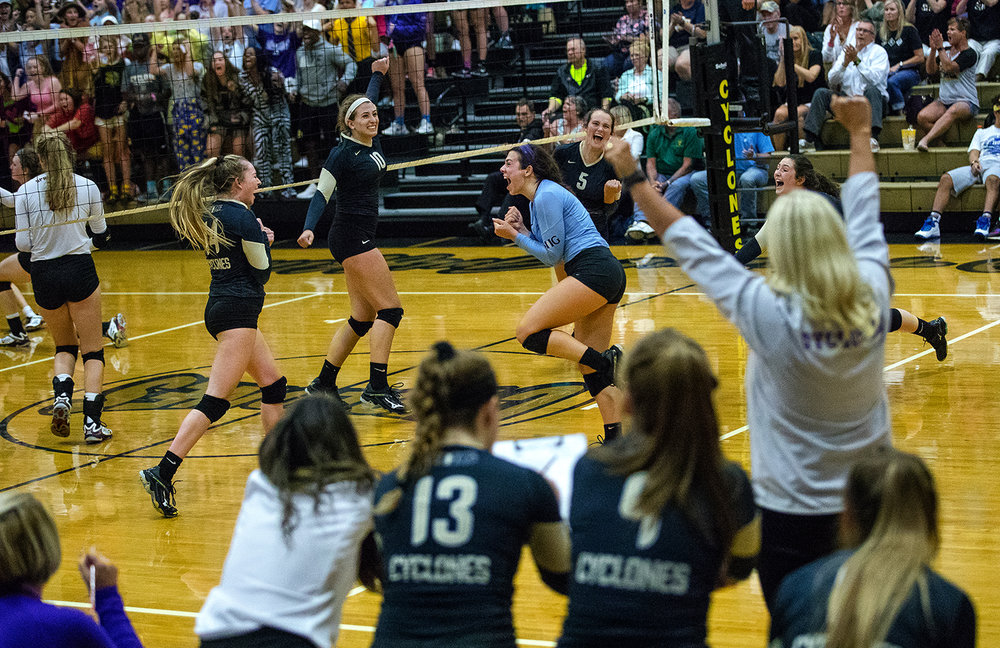 The Cyclones celebrate as they close in on their win against Springfield during the City Volleyball Tournament at Belz Gymnasium Thursday, Sept. 21, 2017. [Ted Schurter/The State Journal-Register]