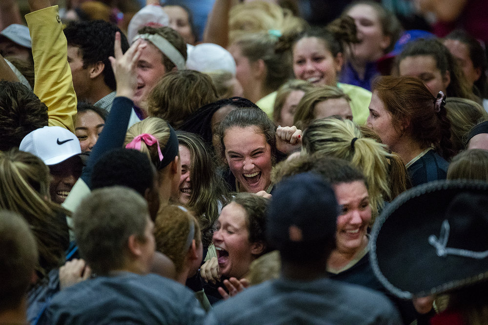 Cyclone fans flood the floor as they celebrate their win against Springfield during the City Volleyball Tournament at Belz Gymnasium Thursday, Sept. 21, 2017. [Ted Schurter/The State Journal-Register]