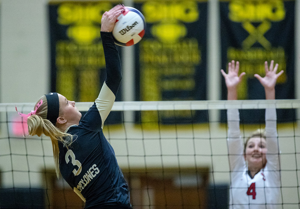 Sacred Heart-Griffin's Bailey Morrow spikes the ball against Springfield during the City Volleyball Tournament at Belz Gymnasium Thursday, Sept. 21, 2017. [Ted Schurter/The State Journal-Register]