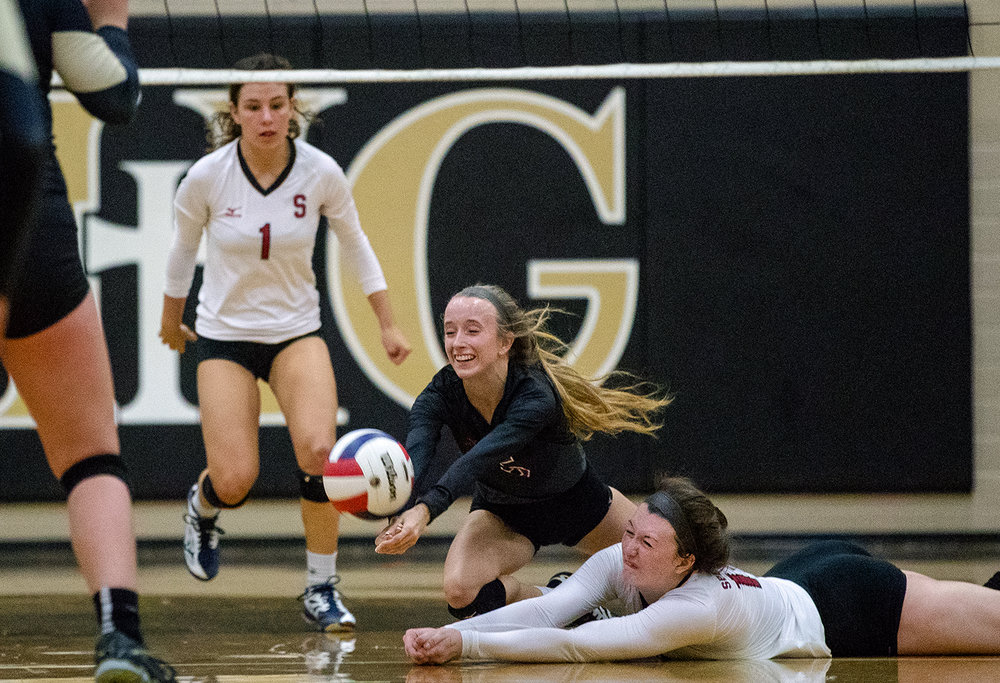 Springfield's Morgan Gill, left, and Abby Ratsch dive for the ball during the City Volleyball Tournament at Belz Gymnasium Thursday, Sept. 21, 2017. [Ted Schurter/The State Journal-Register]