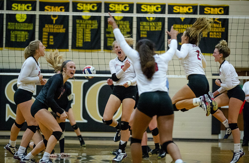 Springfield celebrates a point against Sacred Heart-Griffin during the City Volleyball Tournament at Belz Gymnasium Thursday, Sept. 21, 2017. [Ted Schurter/The State Journal-Register]