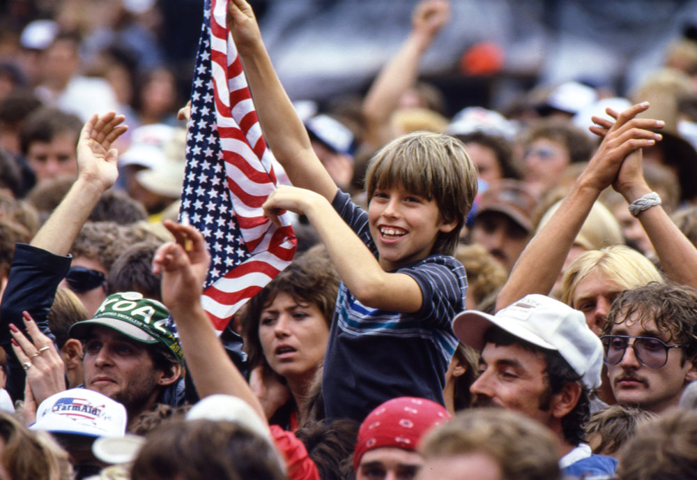 A young fan enjoys the Charlie Daniels performance at the Farm Aid concert at Memorial Stadium in Champaign, Ill. Sept. 22, 1985. [File/The State Journal-Register]