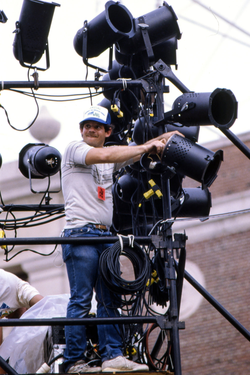 A lighting technician at work during the Farm Aid concert at Memorial Stadium in Champaign, Ill. Sept. 22, 1985. [File/The State Journal-Register]