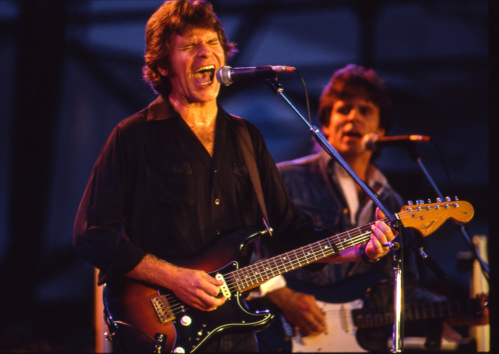 "John Fogerty performed ""The Old Man Down the Road"" and ""Knock on Wood"" at the Farm Aid concert at Memorial Stadium in Champaign, Ill. Sept. 22, 1985. [File/The State Journal-Register]"