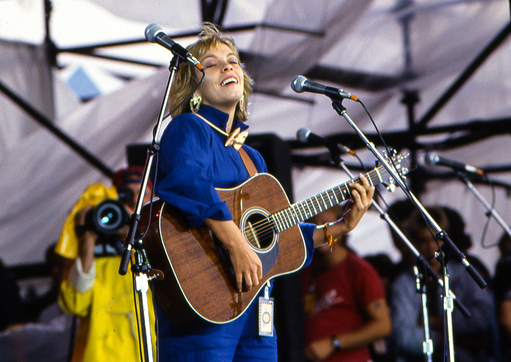 "Rickie Lee Jones performed ""The Last Chance Texaco"" and in a duet with Bonnie Rait, ""Angel from Montgomery"" at the Farm Aid concert at Memorial Stadium in Champaign, Ill. Sept. 22, 1985. [File/The State Journal-Register]"