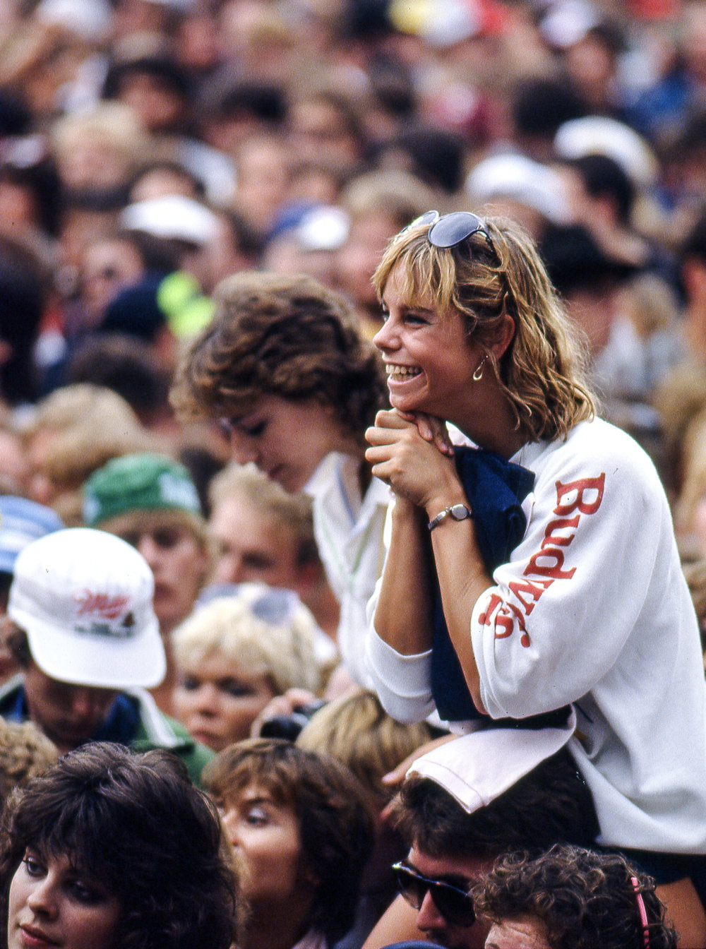 A spectator listens to one of the performers at the Farm Aid concert at Memorial Stadium in Champaign, Ill. Sept. 22, 1985. [File/The State Journal-Register]