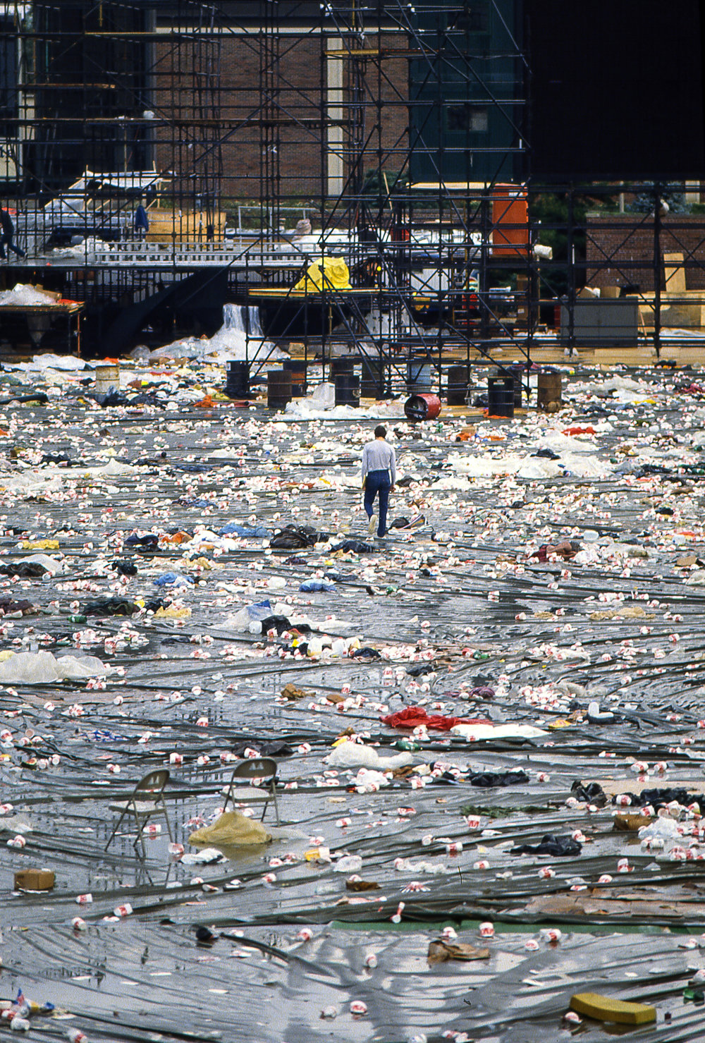 Garbage covers the ground in Memorial Stadium the morning after the Farm Aid concert in Champaign, Ill. Sept. 22, 1985. [File/The State Journal-Register]
