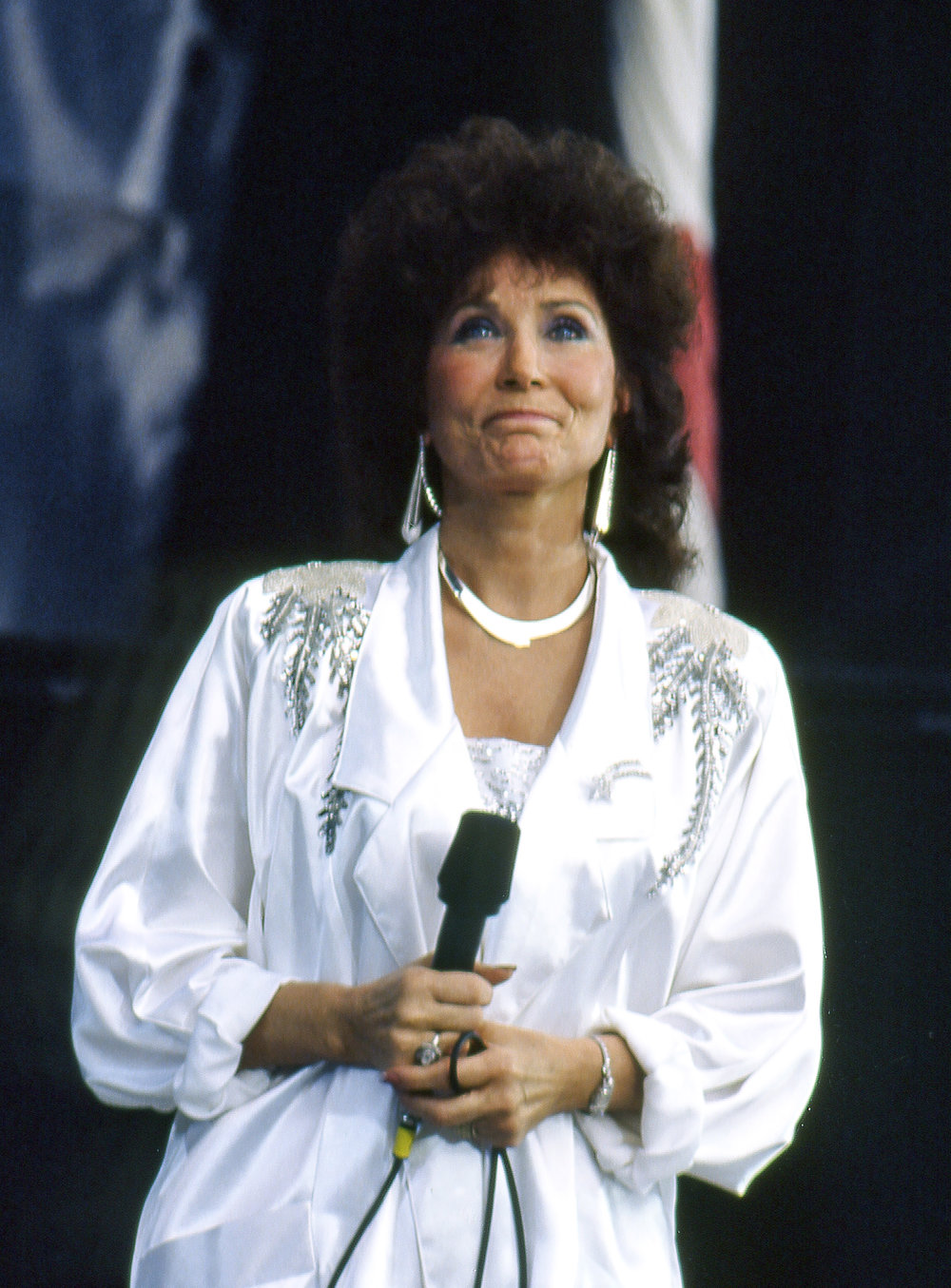 "County music legend Loretta Lynn sang ""Coal Miner's Daughter"" and ""You Ain't Woman Enough (To Take My Man)"" at the Farm Aid concert at Memorial Stadium in Champaign, Ill. Sept. 22, 1985. [File/The State Journal-Register]"