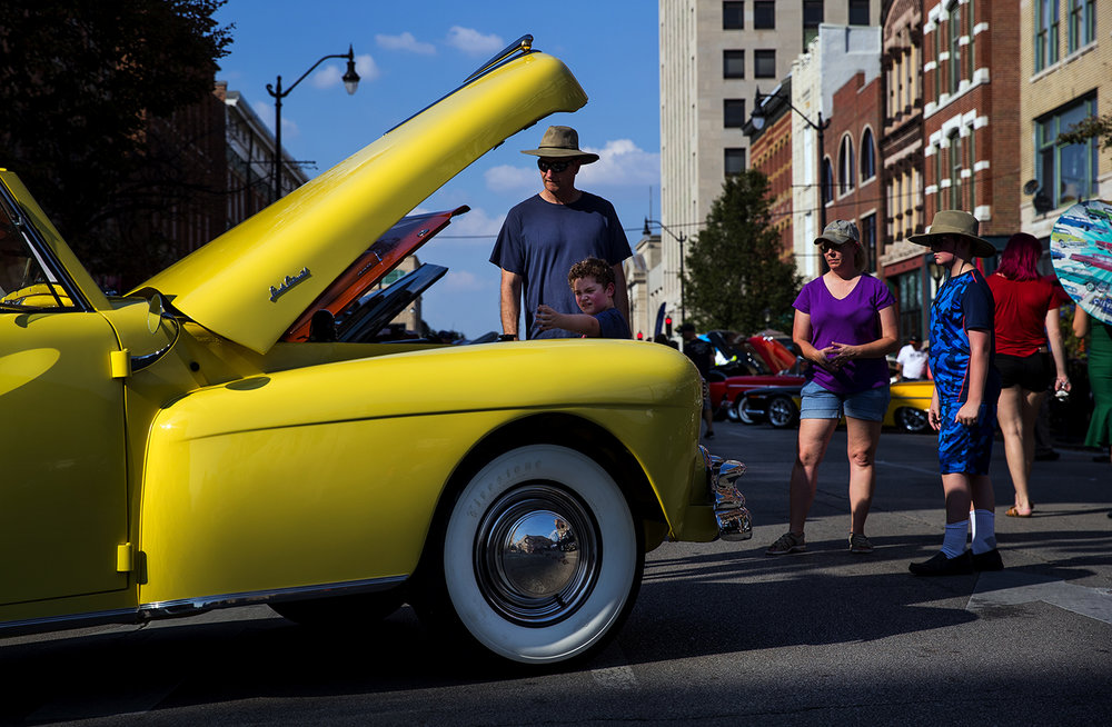 Mark Berger, his sons Ian, left and Noah and wife April Mugler check out a 1948 Lincoln Continental Cabriolet Convertible at the International Route 66 Mother Road Festival in downtown Springfield Saturday, Sept. 23, 2017. The Lincoln is powered by a V12 engine and sold for $4,746 new. [Ted Schurter/The State Journal-Register]