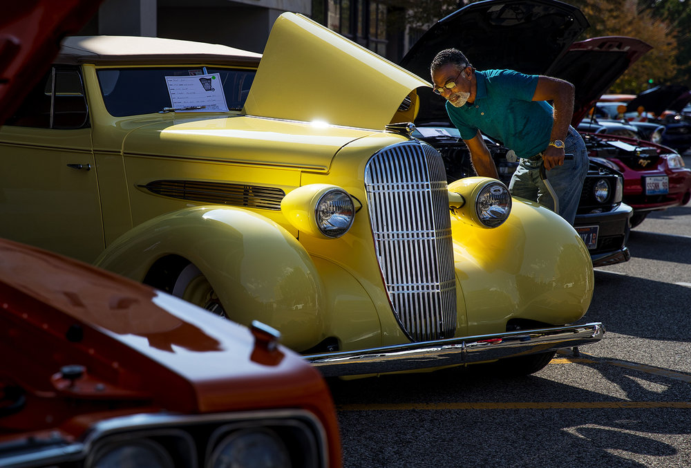 Nolan Renfro checks out a 1935 Oldsmobile convertible during the International Route 66 Mother Road Festival in downtown Springfield Saturday, Sept. 23, 2017. [Ted Schurter/The State Journal-Register]