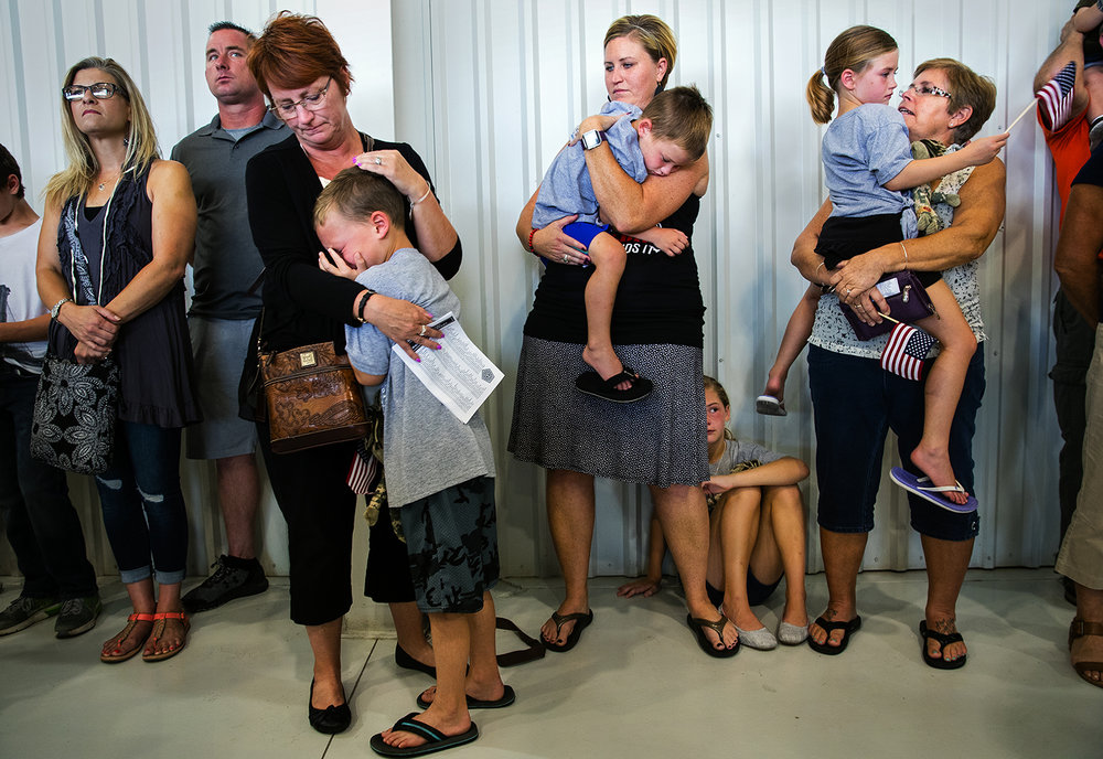Erin Alderson, center, holds her son as her step mother, Lisa Radley, consoles her son Jaxson, her daughter Ava rests at her feet, and her mom, Phyllis Radley, consoles her daughter Emree during a deployment ceremony for the Illinois Army National Guard 3637th Support Maintenance Company Sunday, Sept. 24, 2017. Alderson's husband, and the children's father, Sgt. Brandon Alderson, deployed with the company. [Ted Schurter/The State Journal-Register]