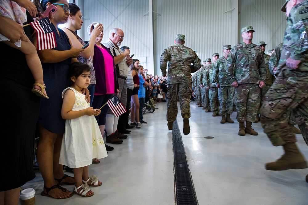 Lily Guiterez watches as the Illinois Army National Guard's 3637th Maintenance Company fall into formation during a deployment ceremony Sunday, Sept. 24, 2017. Guiterez's godfather, Sgt. Miguel Mata, was deploying with the rest of the unit to Kuwait. [Ted Schurter/The State Journal-Register]