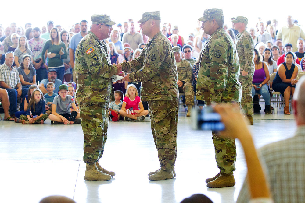 Major Gen. Michael Zerbonia, the Assistant Adjutant General - Army of the Illinois National Guard and Commander of the Illinois Army National Guard presents the Illinois state flag to Capt. Kenneth Sprague of Urbana, the Commander of the 3637th Support Maintenance Company, during a deployment ceremony Sunday, Sept. 24, 2017. First Sgt. Steven Richardson of Streator is at right. [Ted Schurter/The State Journal-Register]