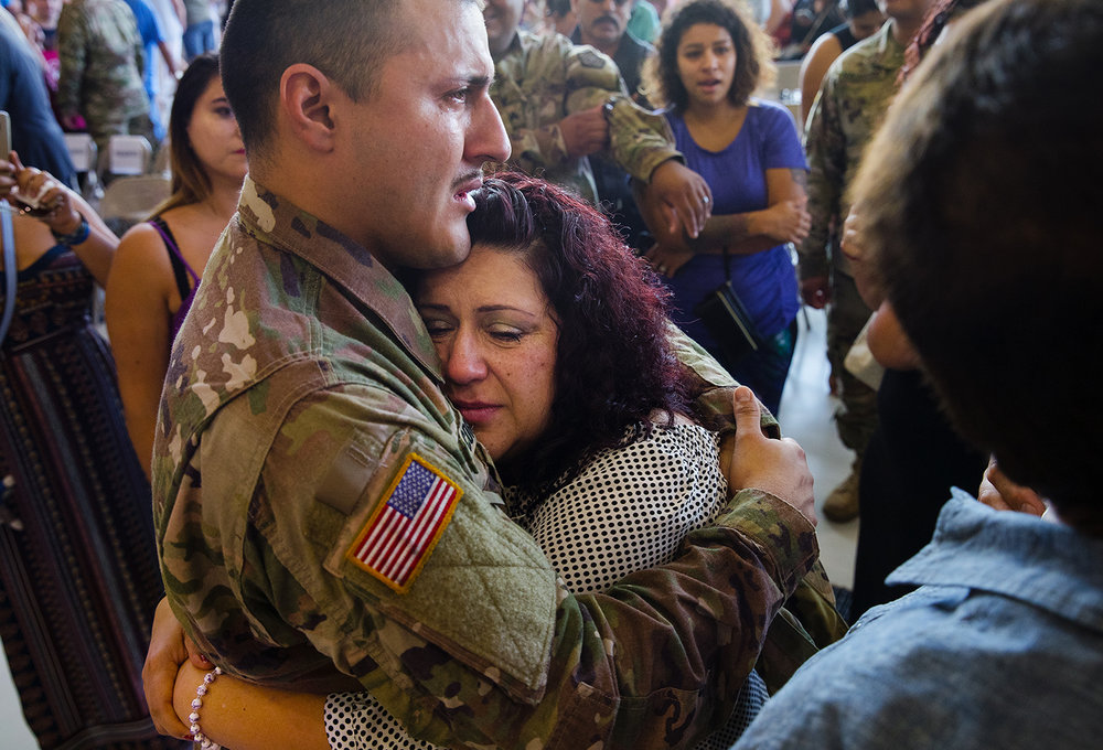 Fidelia Alamo hugs her son Mario Corral after a deployment ceremony for the 3637th Support Maintenance Company Sunday, Sept. 24, 2017. [Ted Schurter/The State Journal-Register]