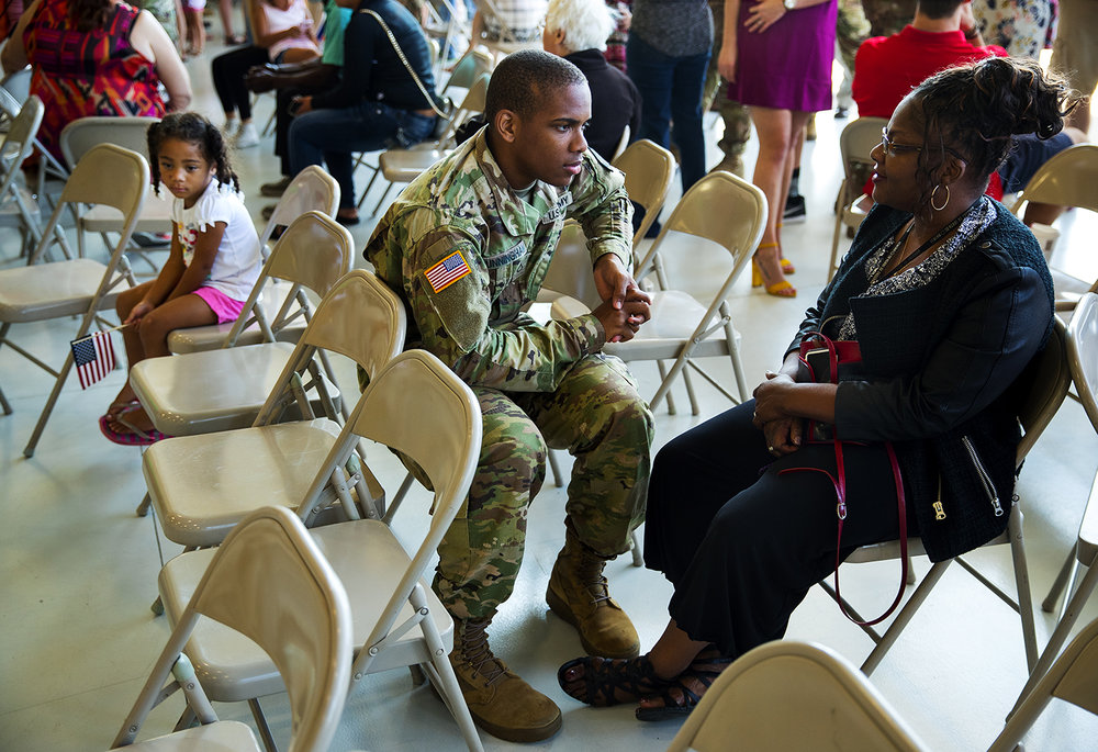 Marcus Cunningham of Lincoln, Ill., talks with his mom Tina before departing with the 3637th Support Maintenance Company after a deployment ceremony at the LRS Hangar at Abraham Lincoln Capital Airport Sunday, Sept. 24, 2017.[Ted Schurter/The State Journal-Register]