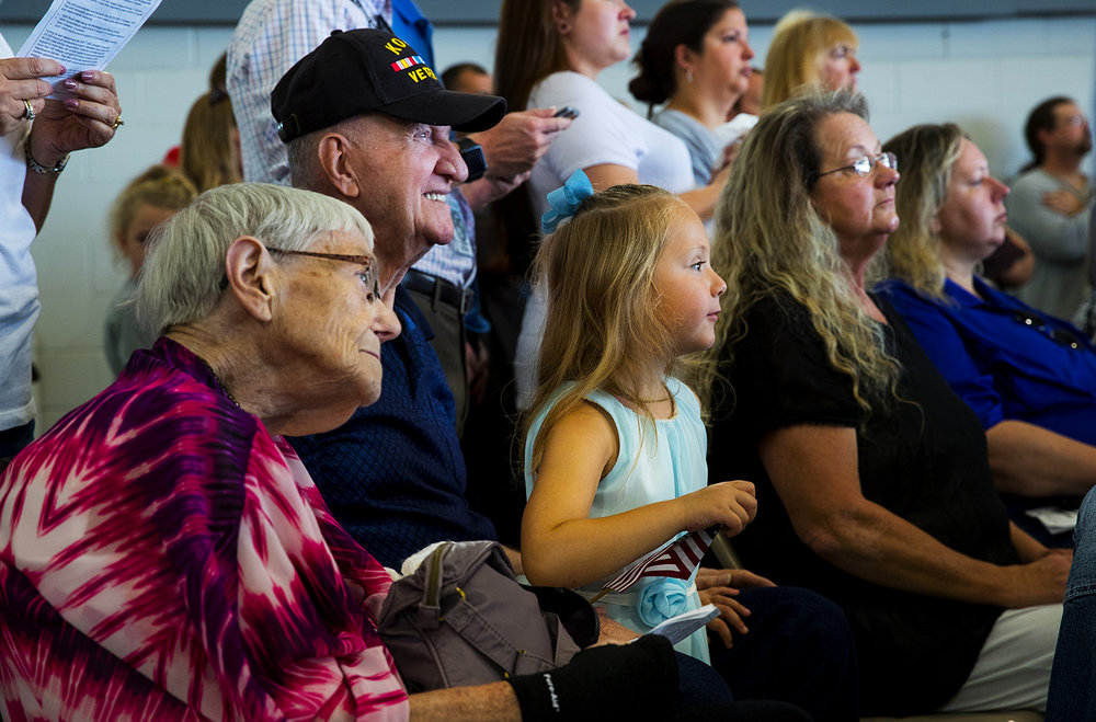Betty and Bud Johnson of Lincoln, Ill., sit with their great granddaughter Kami Werth as she watches her dad Chris during a deployment ceremony the 3637th Support Maintenance Company at the LRS Hangar at Abraham Lincoln Capital Airport Sunday, Sept. 24, 2017. [Ted Schurter/The State Journal-Register]