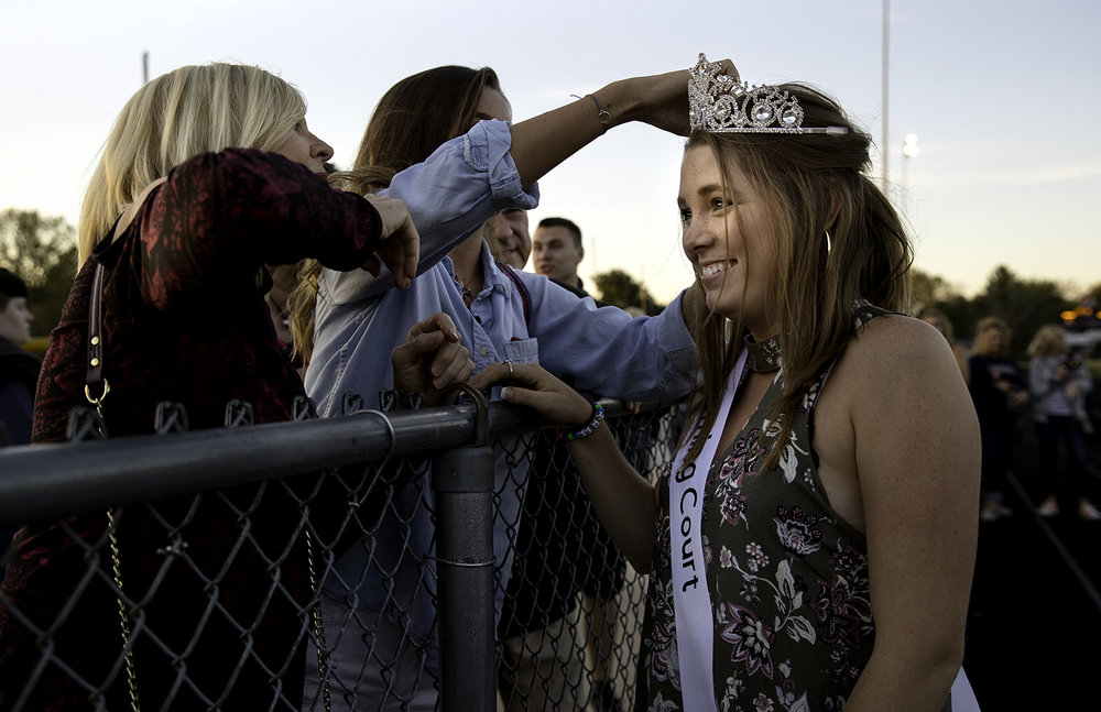 Kathryn Mayes adjusts her sister Julia's homecoming queen crown before kickoff at Rochester High School Friday, Sept. 29, 2017. Kathleen Hayes, Julia's grandmother, is at left. [Ted Schurter/The State Journal-Register]