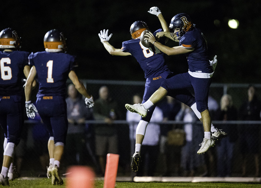 Rochester's Nic Baker and Rochester's Jayden Reed celebrate Baker's second-half touchdown against Decatur MacArthur at Rochester High School Friday, Sept. 29, 2017. [Ted Schurter/The State Journal-Register]
