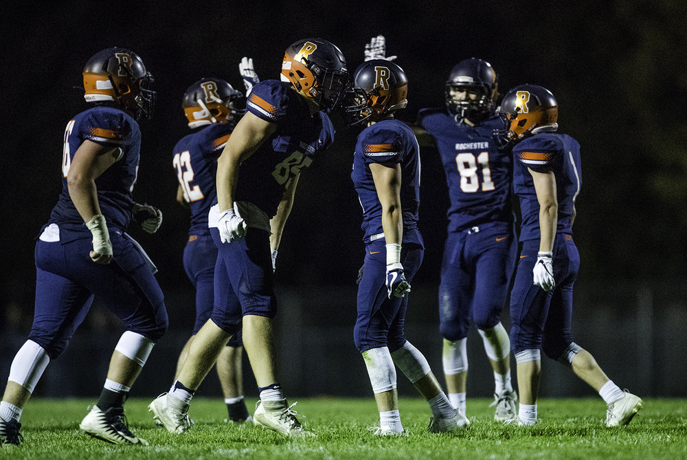 Rochester's Mike McNicholas and Cole Edgington celebrate Edington's fumble recovery at Rochester High School Friday, Sept. 29, 2017. [Ted Schurter/The State Journal-Register]