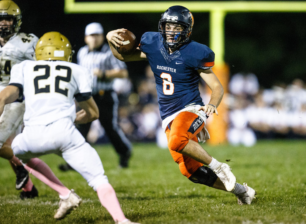 Rochester quarterback Nic Baker (8) cuts back against Sacred Heart-Griffin's Jack Ross (22) on a rush in the second quarter at Rocket Booster Stadium, Friday, Oct. 6, 2017, in Rochester, Ill. [Justin L. Fowler/The State Journal-Register]