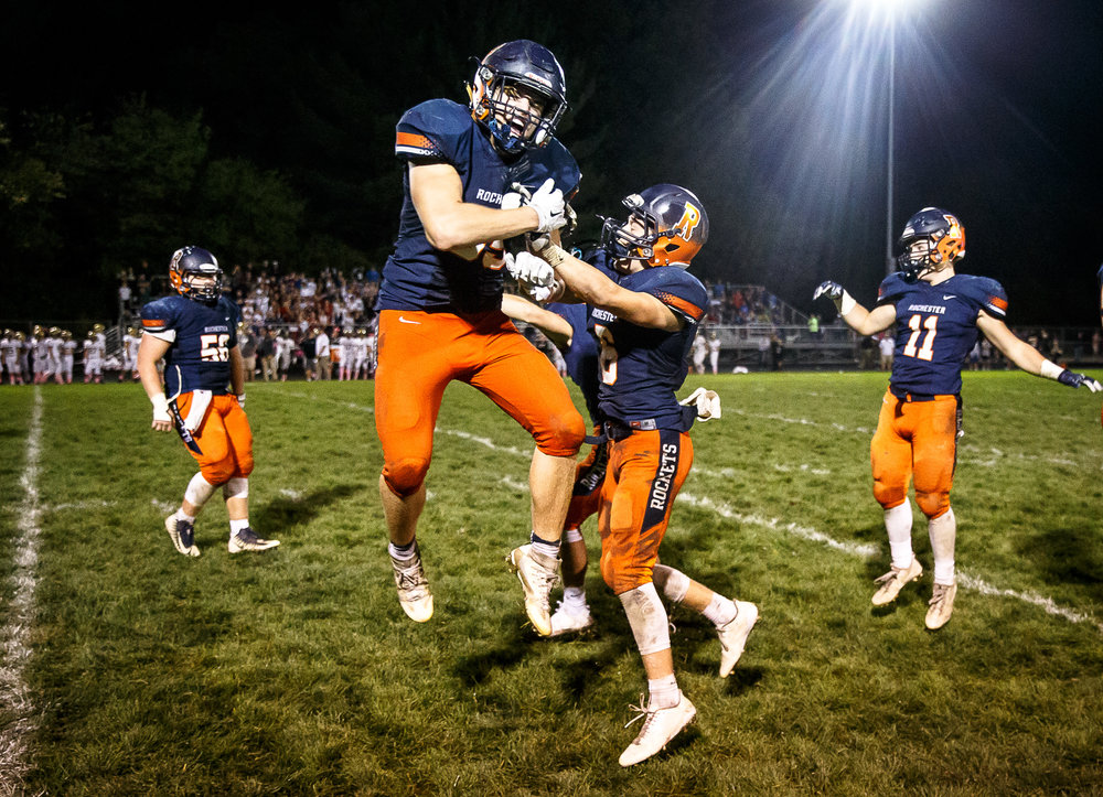 Rochester's Mike McNicholas (85) leaps up in to the air as the Rockets celebrate their 35-28 victory over Sacred Heart-Griffin at Rocket Booster Stadium, Friday, Oct. 6, 2017, in Rochester, Ill. [Justin L. Fowler/The State Journal-Register]
