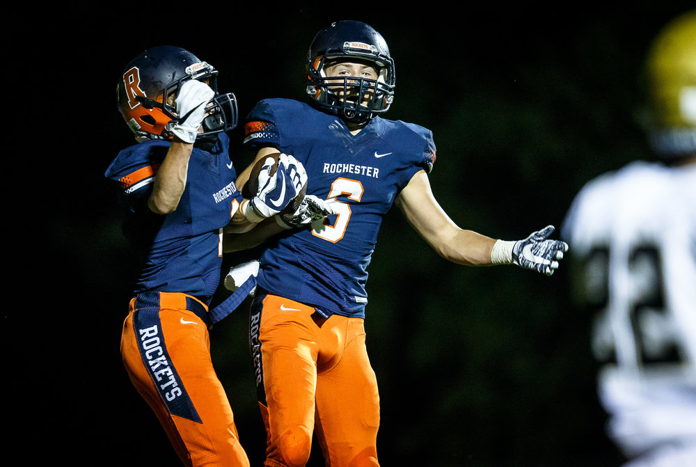 Rochester's Cade Eddington (6) celebrates his touchdown with Rochester's Riley Lewis (1) against Sacred Heart-Griffin in the first quarter at Rocket Booster Stadium, Friday, Oct. 6, 2017, in Rochester, Ill. [Justin L. Fowler/The State Journal-Register]