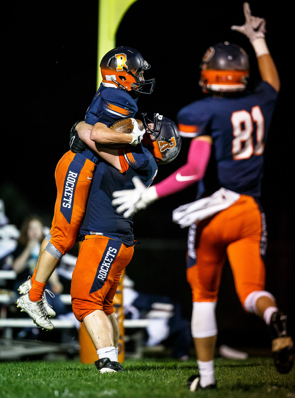 Rochester's Riley Lewis (1) is hoisted up by Rochester's Clay Johnson (71) to celebrate his touchdown against Sacred Heart-Griffin in the first quarter at Rocket Booster Stadium, Friday, Oct. 6, 2017, in Rochester, Ill. [Justin L. Fowler/The State Journal-Register]