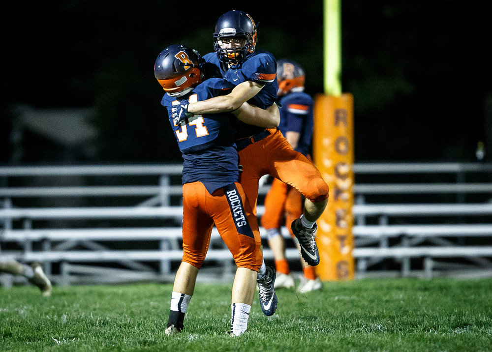 Rochester's Ethan Vose (86) and Rochester's Logan Peters (84) celebrate a Sacred Heart-Griffin turnover in the third quarter at Rocket Booster Stadium, Friday, Oct. 6, 2017, in Rochester, Ill. [Justin L. Fowler/The State Journal-Register]
